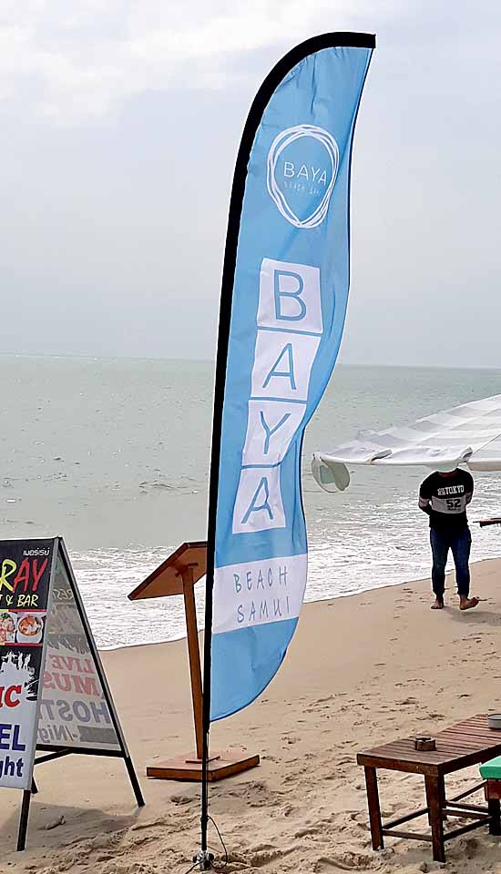 Baya beach restaurant in lamai beach make beautiful beach flags with heavy sand screw