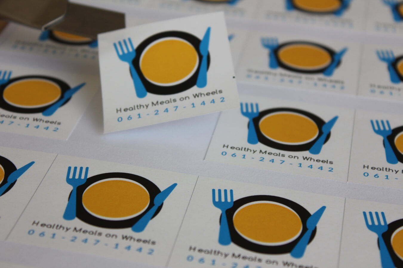 Meals on wheels sticker printing. Sticker is die cut and lay top of of ark