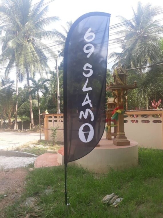 beach flag feather convex in chameleon production office yard taling ngam koh samui