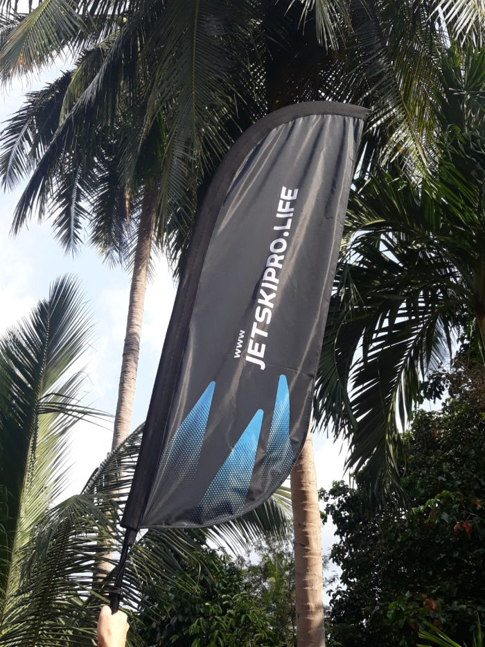 beautiful jetskipro life feather beach flag middle of jungle